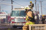 A firefighter from Phoenix, AZ takes a break after working on a 1st alarm HazMat fire.